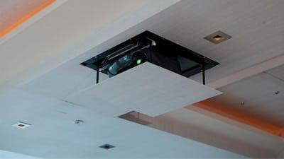Home Theater Projector Concealed in a Ceiling Lift